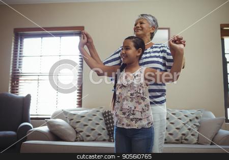 Grandmother and granddaughter having fun in living room stock photo, Grandmother and granddaughter having fun in living room at home by Wavebreak Media
