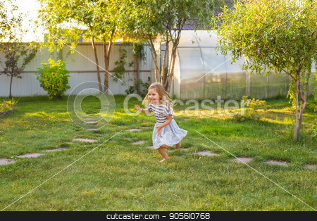Cute little girl is playing in summer park stock photo, Cute little girl is playing in summer park by Satura86