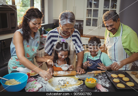 Happy family preparing dessert in kitchen stock photo, Happy family preparing dessert in kitchen at home by Wavebreak Media