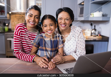 Portrait of smiling multi-generation family in kitchen stock photo, Portrait of smiling multi-generation family in kitchen at home by Wavebreak Media