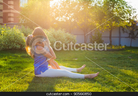 Portrait of happy loving mother and her baby outdoors stock photo, Portrait of happy loving mother and her baby outdoors by Satura86