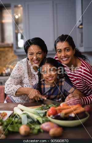Portrait of smiling multi-generation family preparing food in kitchen stock photo, Portrait of smiling multi-generation family preparing food together in kitchen at home by Wavebreak Media
