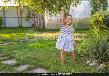 happy child girl playing on meadow in summer in nature stock photo, happy child girl playing on meadow in summer in nature by Satura86