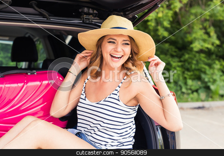 Pretty woman portrait at the car trunk with suitcases stock photo, Pretty woman portrait at the car trunk with suitcases by Satura86