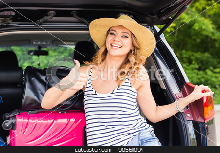 Travel, tourism - woman sitting in the trunk of a car with suitcases, showing thumb up sign, ready to leave for vacations stock photo, Travel, tourism - woman sitting in the trunk of a car with suitcases, showing thumb up sign, ready to leave for vacations by Satura86