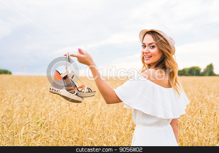 Woman holding shoe. Women loves shoes concept stock photo, Woman holding shoe. Women loves shoes concept. Young woman holding a shoe - sale, consumerism and people concept by Satura86