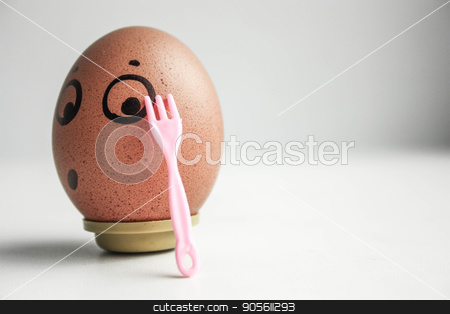 An egg with a painted face. Cute egg. Photo