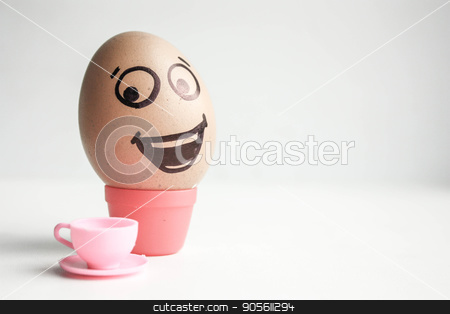 An egg with a painted face. Cute egg. Photo stock photo, Breakfast with coffee concept. An egg with a painted face. Cute egg. Photo for your design by Kseniia