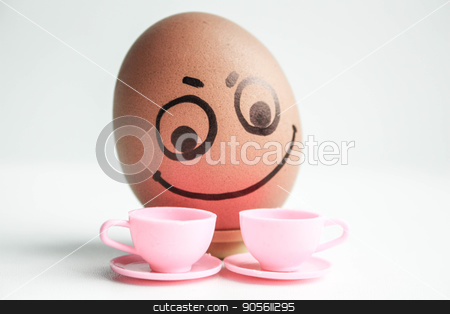 An egg with a painted face. Cute egg. Photo stock photo, Breakfast with coffee concept. Choice of tea or coffee. An egg with a painted face. Cute egg. Photo for your design by Kseniia