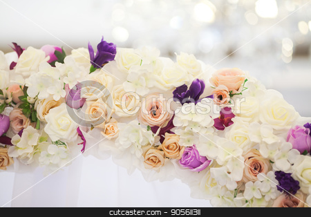 flower arch from fresh colors for a wedding ceremony at restaurant on a white background with a light wedding decor. stock photo, flower arch from fresh colors for a wedding ceremony closeup. wedding decor concept. by Dmitry
