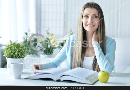 young woman with opened book stock photo, Portrait of beautiful young woman with opened book by Ruslan Huzau