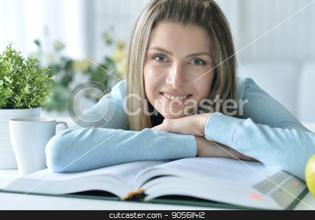 young woman with opened book stock photo, Portrait of a beautiful young woman with opened book by Ruslan Huzau