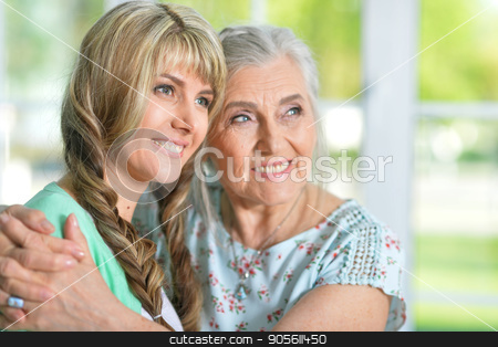 Beautiful young woman with mother stock photo, Family portrait of beautiful young woman with her mother by Ruslan Huzau