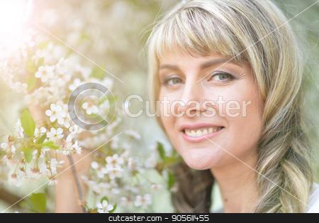Portrait of beautiful young woman stock photo, Portrait of beautiful young woman holding blooming tree brunch by Ruslan Huzau