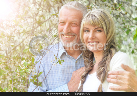 Father and daughter in spring forest  stock photo, Family portrait of father and daughter in spring forest by Ruslan Huzau