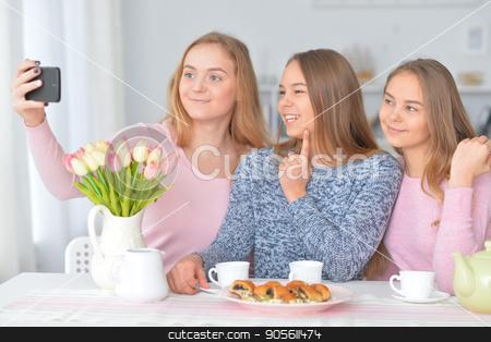 girls making selfie stock photo, Portrait of three teenage girls making selfie by Ruslan Huzau
