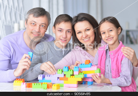 family collecting blocks together stock photo, Portrait of a happy family collecting colorful blocks together by Ruslan Huzau