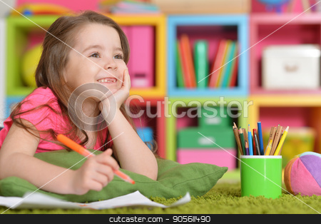 little girl in pink shirt drawing stock photo, Cute little girl in pink shirt drawing in her room by Ruslan Huzau