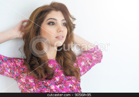 Portrait of beautiful young woman stock photo, Portrait of beautiful brunette young woman on white wall background by Ruslan Huzau
