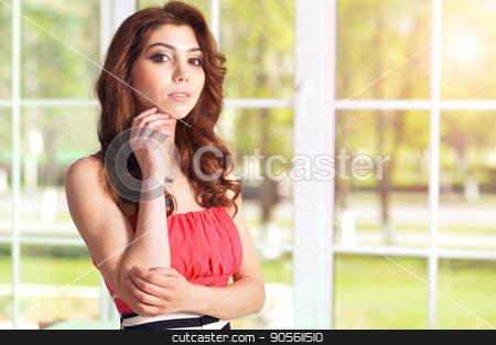 Beautiful young woman with digital tablet  stock photo, Portrait of beautiful young woman with curly hair by Ruslan Huzau