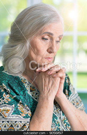 Sad senior woman stock photo, Portrait of sad senior woman, close up by Ruslan Huzau
