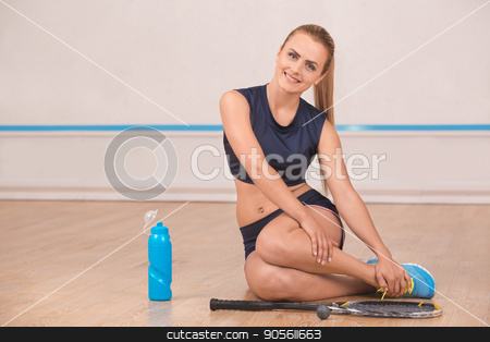 Young woman squash player break rest in the gym stock photo, Young blonde woman rest in the gym squash game play by Dmytro Sidelnikov