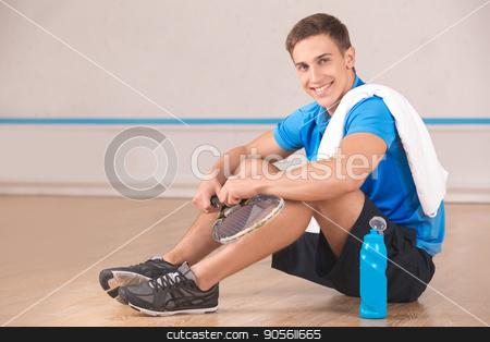 Young man squash player break rest in the gym stock photo, Young man rest in the gym squash game play by Dmytro Sidelnikov