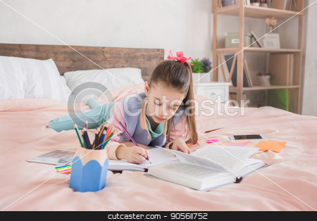 Young teenager girl alone at home childhood stock photo, Young teenager girl alone at home childhood doing homework by Dmytro Sidelnikov