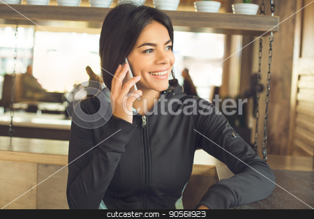 Young woman sitting indoor sportswear healthy lifestyle stock photo, Young femalesitting indoor sportswear healthy lifestyle using digital device by Dmytro Sidelnikov
