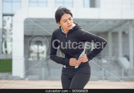 Young woman active exercise workout on street outdoor stock photo, Young femaleactive exercise workout on street outside pain by Dmytro Sidelnikov