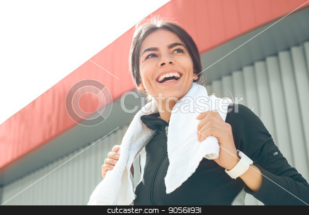 Young woman active exercise workout on street outdoor stock photo, Young femaleactive exercise workout on street outside holding towel by Dmytro Sidelnikov