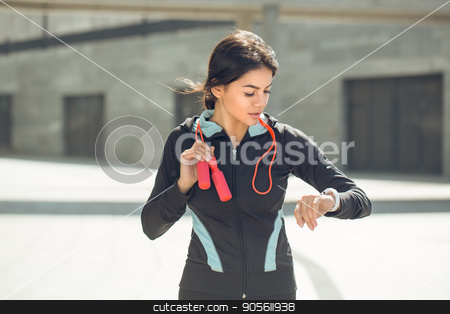 Young woman active exercise workout on street outdoor stock photo, Young femaleactive exercise workout on street outside with skipping rope by Dmytro Sidelnikov