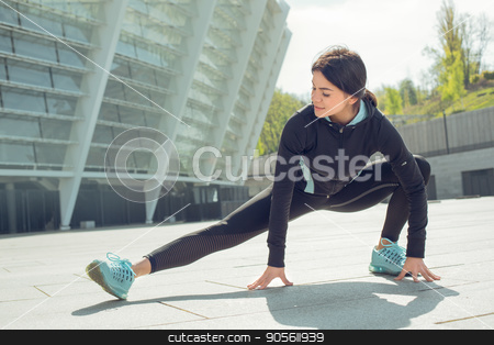 Young woman active exercise workout on street outdoor stock photo, Young femaleactive exercise workout on street outside stretching by Dmytro Sidelnikov