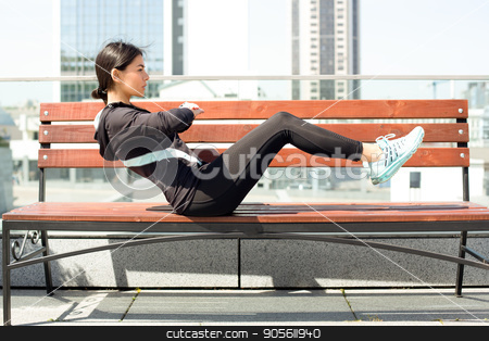 Young woman active exercise workout on street outdoor stock photo, Young femaleactive exercise workout on street outside by Dmytro Sidelnikov