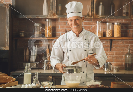 Bakery chef cooking bake in the kitchen professional stock photo, Bakery chef cooking bake in the kitchen professional sift the flour by Dmytro Sidelnikov