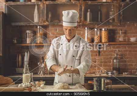 Bakery chef cooking bake in the kitchen professional stock photo, Bakery chef cooking bake in the kitchen professional knead dough by Dmytro Sidelnikov