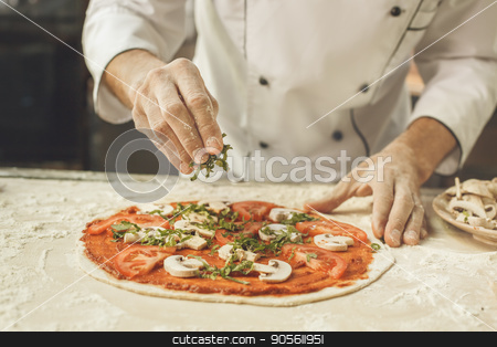 Bakery chef cooking bake in the kitchen professional stock photo, Bakery chef cooking bake in the kitchen professional making pizza by Dmytro Sidelnikov