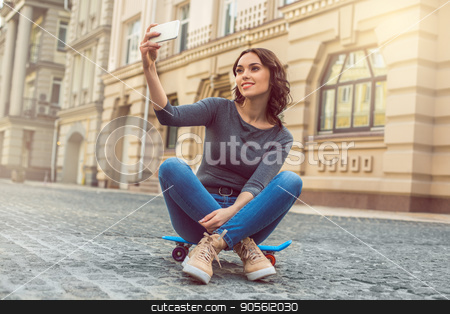 Young woman city walk tourist vacation lifestyle stock photo, Young female city walk tourist vacation lifestyle with skateboard by Dmytro Sidelnikov