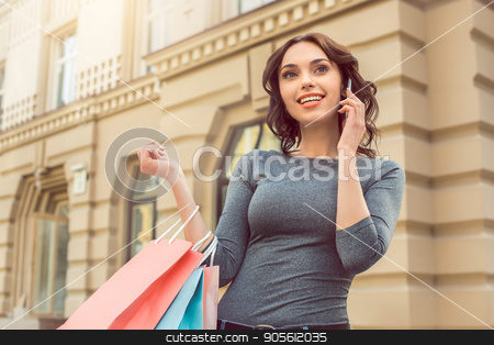Young woman city walk tourist vacation lifestyle stock photo, Young woman city walk tourist vacation lifestyle with shopping bags by Dmytro Sidelnikov