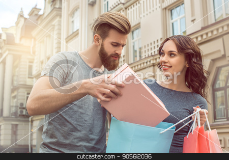 Young couple tourists city walk together vacation stock photo, Young couple woman and man tourists city walk together vacation shopping by Dmytro Sidelnikov