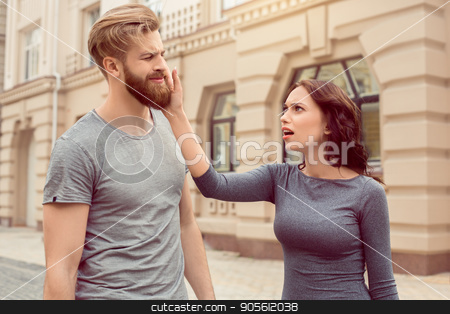 Young couple tourists city walk together vacation stock photo, Young couple woman and man tourists city walk together vacation quarrel by Dmytro Sidelnikov