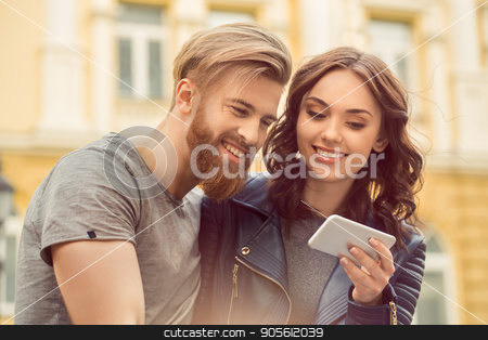 Young couple tourists city walk together vacation stock photo, Young couple woman and man tourists city walk together vacation using digital device by Dmytro Sidelnikov