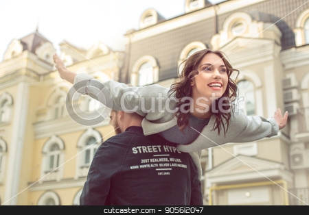 Young couple tourists city walk together vacation stock photo, Young couple woman and man tourists city walk together vacation male carry female by Dmytro Sidelnikov