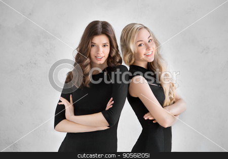 Young women together celebrating hen party isolated on white stock photo, Young female friends together celebration white background standing confident by Dmytro Sidelnikov