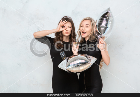Young women together celebrating hen party isolated on white stock photo, Young female friends together celebration white background with balloons by Dmytro Sidelnikov