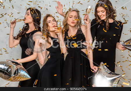 Young women together celebrating hen party isolated on white stock photo, Young female friends together celebration white background dance by Dmytro Sidelnikov
