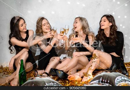 Young women together celebrating hen party isolated on white stock photo, Young female friends together celebration white background by Dmytro Sidelnikov