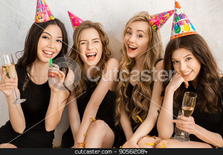 Young women together celebrating birthday isolated on white stock photo, Young female friends together celebration white background fun by Dmytro Sidelnikov