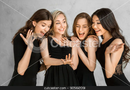 Young women together celebrating hen party isolated on white stock photo, Young female friends together celebration white background showing ring by Dmytro Sidelnikov