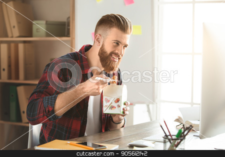 Young man architect working in the office ocuupation stock photo, Young male architect working indoors unhealthy meal by Dmytro Sidelnikov